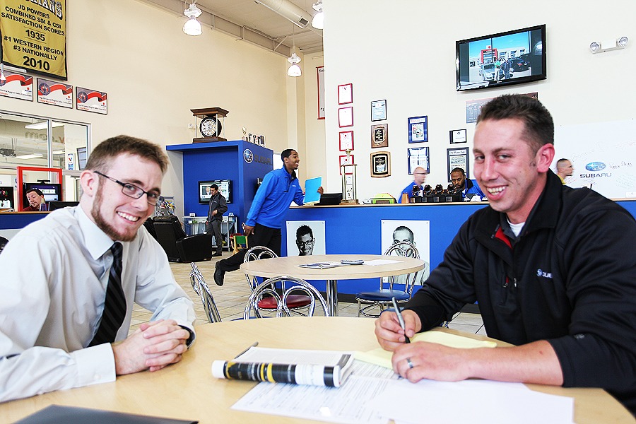 Alec (L) and Kasey, Filling Out New Hire Paperwork