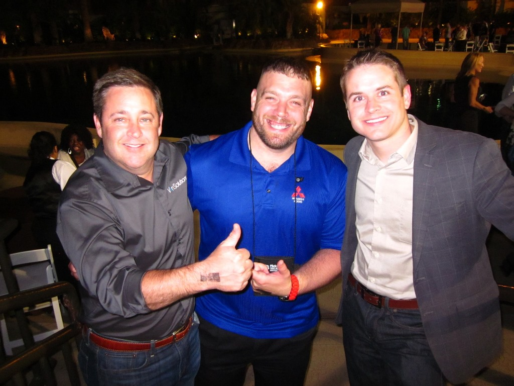 Sean Stapleton, Richard Herod, and Michael Groves at the VinSolutions after-hours party