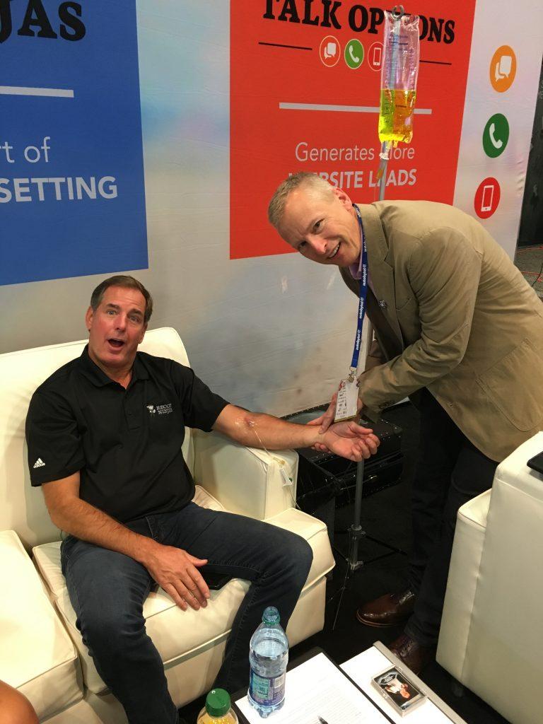 Helping Jerry Thibeau rehydrate in the Vegas heat