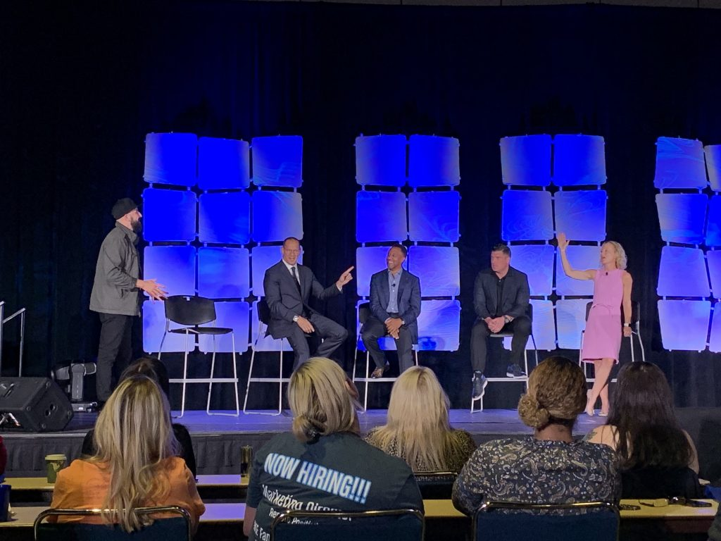 Paul Daly leads keynote with Brian Benstock, Damon Lester, Brian Kramer, and Liza Borches